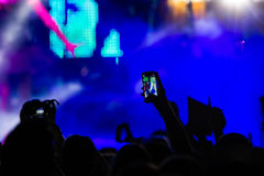 People taking photographs with touch smart phone during a music Royalty Free Stock Photography
