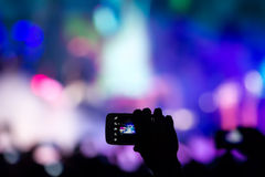People taking photographs with touch smart phone during a music Royalty Free Stock Photos