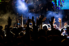 People taking photographs with touch smart phone during a music Stock Images