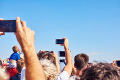 People taking photos of the airplane with their smartphones stock photo