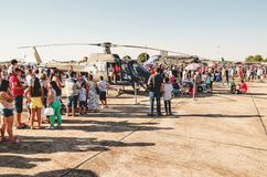People taking photos with a Brazilian army helicopter. Campo Grande, Brazil - September 09, 2018: People taking photos with a Brazilian army helicopter at the stock photography