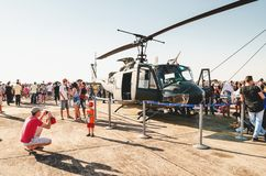 People taking photos with a Brazilian army helicopter. Campo Grande, Brazil - September 09, 2018: People taking photos with a Brazilian army helicopter at the royalty free stock photography