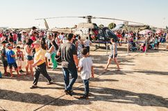 People taking photos with a Brazilian army helicopter. Campo Grande, Brazil - September 09, 2018: People taking photos with a Brazilian army helicopter at the royalty free stock images