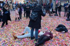 People taking photos on ground covered by confetti stock photo