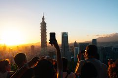 People Taking Photos of High-rise Buildings royalty free stock photos