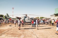 People taking photos with the Navy helicopter: Marinha N-7057. Campo Grande, Brazil - September 09, 2018: People at the military air base to visit the Portoes royalty free stock photo