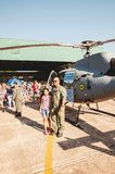 People taking photos with the Navy helicopter: Marinha N-7057. Campo Grande, Brazil - September 09, 2018: People at the military air base to visit the Portoes stock image