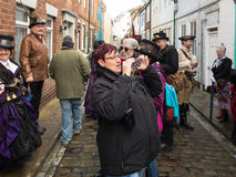 People taking photos of participants in Whitby Goth Weekend Royalty Free Stock Images