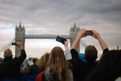 People Taking Picture at Tower Bridge Under Gray Clouds Stock Images