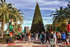 People taking pictures with Christmas tree and nutcrackers in Lake Eola Park at Orlando Downtown area. Orlando, Florida . December 24, 2018. People taking royalty free stock photos