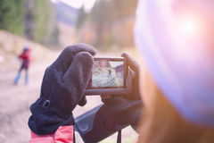 People taking pictures of each other. Royalty Free Stock Images