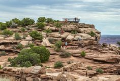 People taking pictures including selfies at the viewpoint overlooking the Colorado River. At Dead Horse State Park in Utah, USA royalty free stock photos