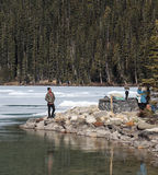 People   taking pictures at Lake Louise and mountains Royalty Free Stock Photo