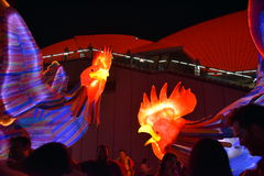 People taking pictures at the larger than life lantern in the shape of Rooster. Sydney, Australia - Jan 28, 2017. People taking pictures at the larger than life royalty free stock image