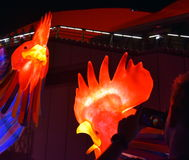 People taking pictures at the larger than life lantern in the shape of Rooster. Sydney, Australia - Jan 28, 2017. People taking pictures at the larger than life royalty free stock photography