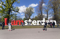 People taking pictures of the letters I amsterdam in the vondelp Royalty Free Stock Images