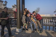 People taking pictures in the scenic spot of kuizi town. A group of deaf and dumb people took a group photo at the scenic spot in wuhu, anhui province stock images