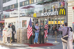People taking pictures and selfies at check point Charlie, Berlin, Germany. Stock Image