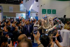 People taking pictures with TITAN - The Greeting Robot stock images