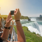 People taking pictures during the tourist tour to Niagara Falls at sunny summer day Stock Photography