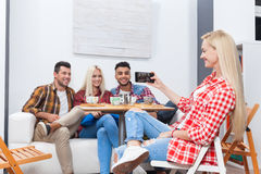 People taking selfie friends pictures drinking coffee shop with barista sitting table mix race men hold smart phone Royalty Free Stock Image
