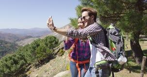 People taking selfie while hiking stock footage