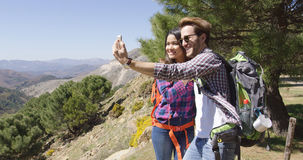 People taking selfie while hiking Stock Photography