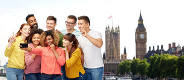People taking selfie by smartphone in london Stock Images