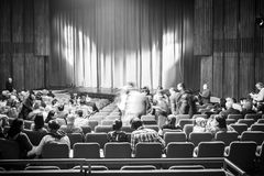 People Taking Their Seats In Theater Inside Royalty Free Stock Image
