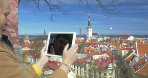 People Taking Top View Photos of Historic City of stock footage