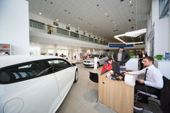 People talk with Consultant in office of Volkswagen Center stock image