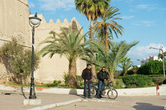 People talk at the street in Sfax, Tunisia. Stock Photos