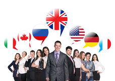 People talking with foreign speech bubbles. Group of business people talking with foreign speech bubbles stock image