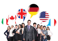 People talking with foreign speech bubbles. Group of business people talking with foreign speech bubbles Stock Photos