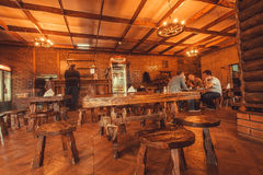 People talking inside traditional cafe with wooden furniture Stock Images