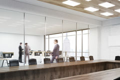 People talking near office cubicle. People talking in office. Their colleague going to other floor. Conference room with table and chairs in foreground.3d Stock Photos
