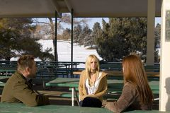 People Talking in the Park stock photography