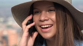 People Talking On Phones. Hispanic pretty teen girl on phone Royalty Free Stock Photo