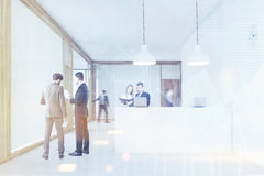 People talking and walking near the reception desk, toned Stock Photo