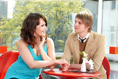 People tallking in restaurant. stock image