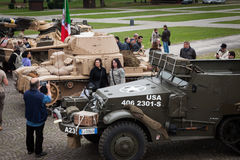 People and tanks at Militalia 2013 in Milan, Italy Royalty Free Stock Image