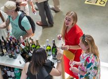 Kyiv Wine Festival by Good Wine in Ukraine. People taste sparkling wine at Kyiv Wine Festival booth. 77 winemakers from around the world took part in the big stock images