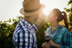 People tasting wine in vineyard Royalty Free Stock Image