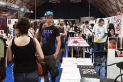 People at tattoo convention in Milan, Italy Stock Photo
