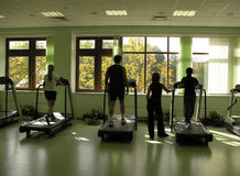 People with teacher in health club. And autumn in window royalty free stock images