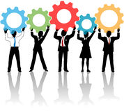 People team up technology solution gears. Team of business tech people hold up technology gear collaboration solution Stock Photography
