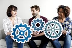 People with teamwork concept sitting together Stock Photo