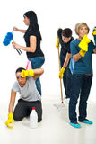 People teamwork work to cleaning house. Four people teamwork working hard to cleaning house and all of them do different work stock photos