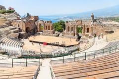 People in Teatro antico di Taormina in summer Stock Photo