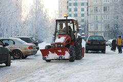 People and technics clean snow from street Stock Photo